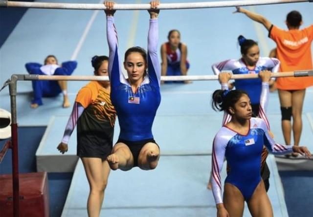 Nữ VĐV bơi lội, thể dục dụng cụ phải mặc trang phục đạo Hồi