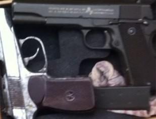 Hai khẩu súng trong cốp xe SH