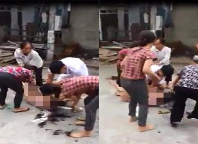 5 người lột quần áo, cắt tóc một phụ nữ giữa đường