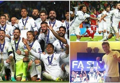 Ramos xoa đầu HLV Zidane để ăn mừng chiến thắng