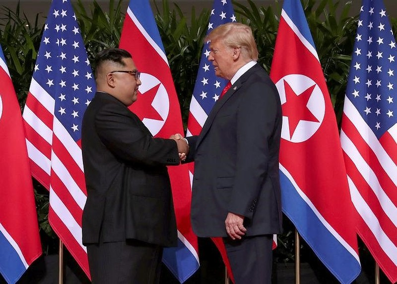 Chùm ảnh: Những khoảnh khắc lịch sử của ông Trump và ông Kim - ảnh 2