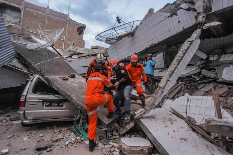 Những hình ảnh rúng động thế giới về thảm họa ở Indonesia   - ảnh 3