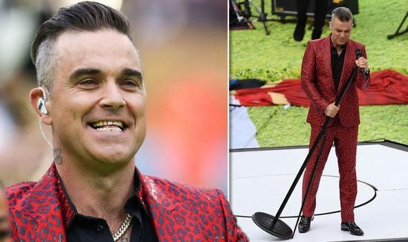 """Giải mã """"ngón tay thối"""" của Robbie Williams - ảnh 1"""