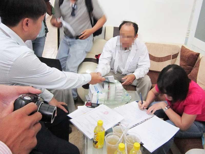 Phòng khám Trung Quốc chuyên 'hù' và 'vẽ' bệnh  - ảnh 1