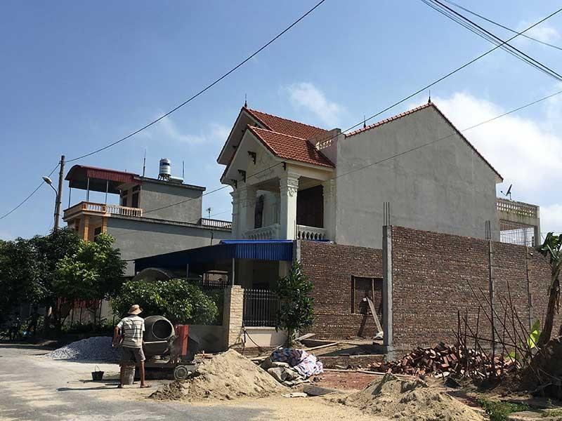 Nhận đất, xây nhà xong… dài cổ chờ giấy đỏ - ảnh 1