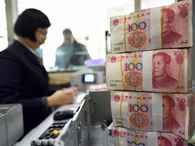 Trung Quốc hạ giá nhân dân tệ để đối phó Mỹ - ảnh 1