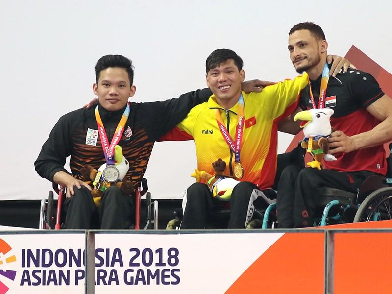 Võ Thanh Tùng lập 'hat trick vàng' tại Asian Para Games - ảnh 1
