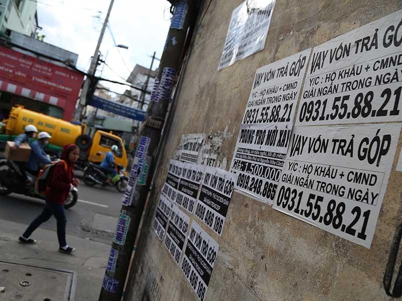Ngân hàng ra tay chặn tín dụng đen - ảnh 1