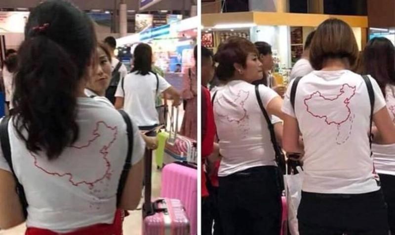 Xin ý kiến Bộ Công an xử lý vụ du khách mặc áo hình lưỡi bò - ảnh 1