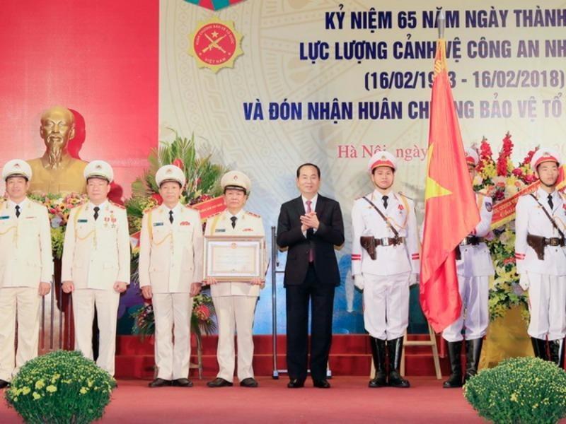 Chủ tịch nước dự kỷ niệm 65 năm lực lượng cảnh vệ CAND - ảnh 1