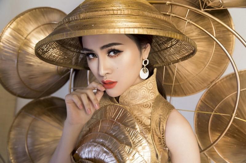 Người đẹp Việt mang nón lá 25kg thi hoa hậu du lịch sinh thái  - ảnh 1