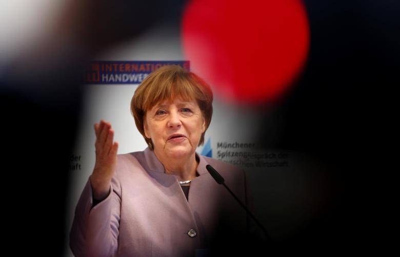 Thủ tướng Đức Angela Merkel trong một cuộc họp báo tại Đức ngày 13-3. Ảnh: REUTERS