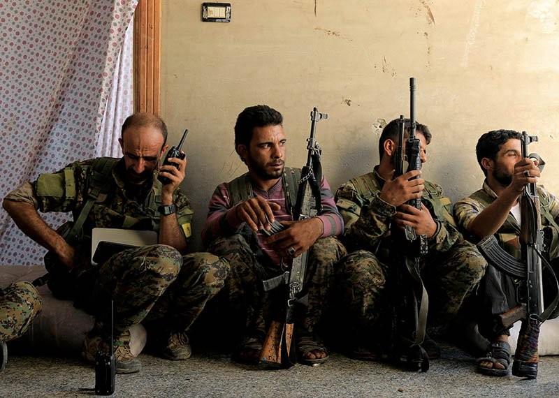 Các tay súng lực lượng nổi dậy Syria. Ảnh: REUTERS