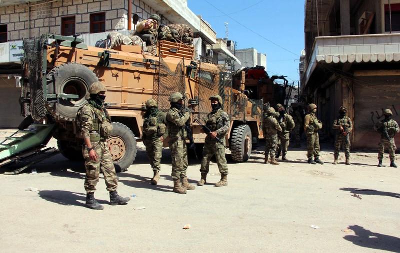 Binh sĩ Thổ Nhĩ Kỳ tại TP Afrin ngày 19-3. Ảnh AP