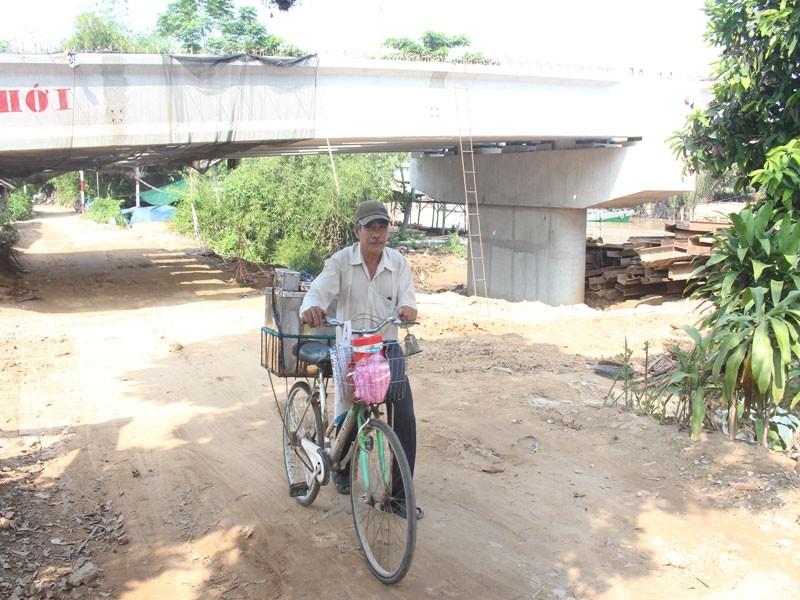 Cầu Mỏ Cày 2 xây thấp, phải 'nạo' nền đường dân sinh - ảnh 3