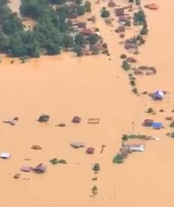 19 người chết và 49 người vẫn còn mất tích sau khi một đập phụ thuộc dự án thủy điện Xi-Pian Xe-Namnoy ở Lào vỡ tối 23-7. Ảnh: EXPRESS