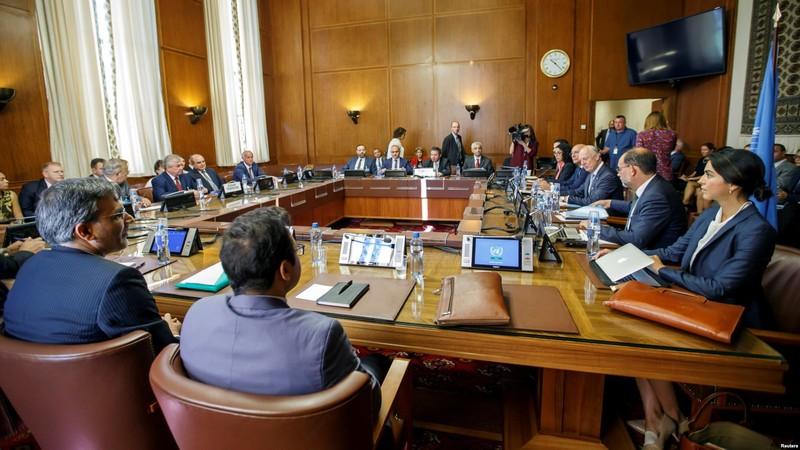 Quang cảnh cuộc gặp giữa đại diện Thổ Nhĩ Kỳ, Nga, Iran về Syria tại trụ sở LHQ ở Geneva (Thụy Sĩ) ngày 11-9. Ảnh: REUTERS
