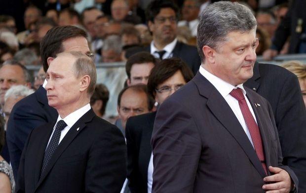Tổng thống Petro Peroshenko nói Tổng thống Nga Vladimir Putin từ chối nói chuyện với ông về sự việc Nga bắt ba tàu Ukraine. Ảnh: URIAN