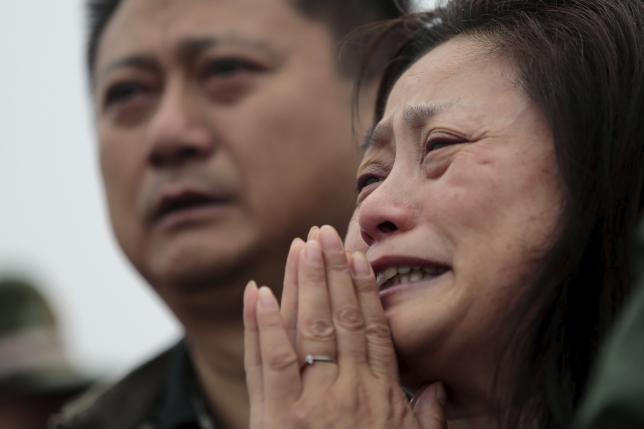 Cảnh sát Trung Quốc bị tố đánh người nhà nạn nhân vụ đắm tàu - ảnh 1