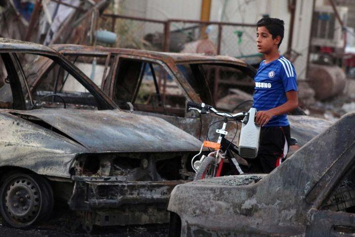 Đánh bom hàng loạt ở thủ đô Iraq, 24 người chết - ảnh 1