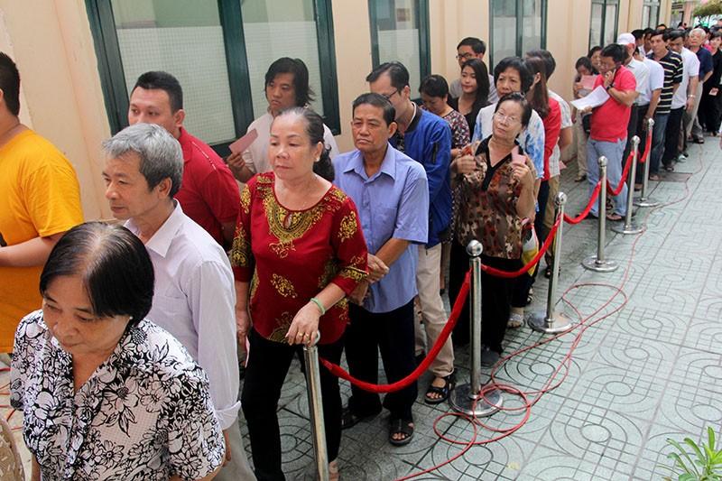 Chùm ảnh: Bí thư Đinh La Thăng đi bầu cử từ sáng sớm - ảnh 8