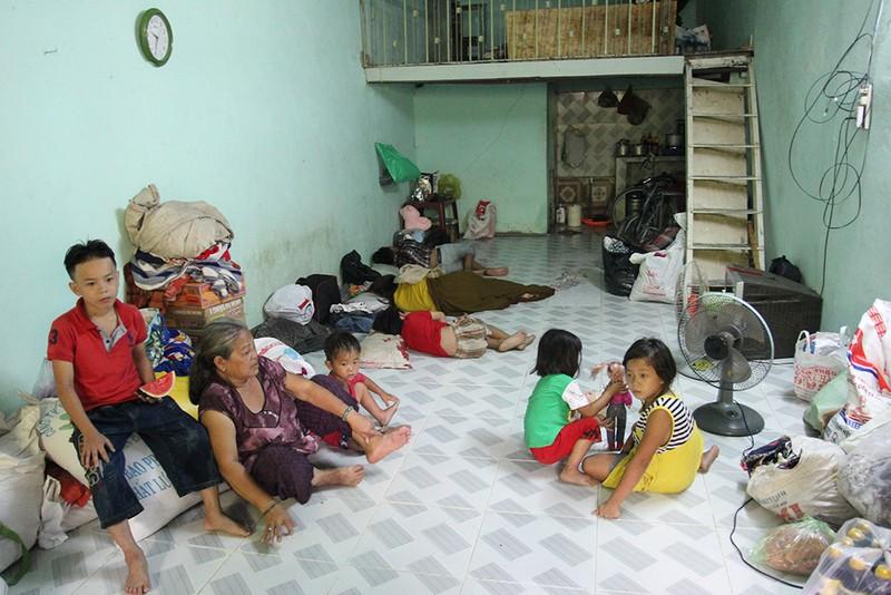 Chùm ảnh: Gia đình 17 người chuyển đến nhà mới - ảnh 14