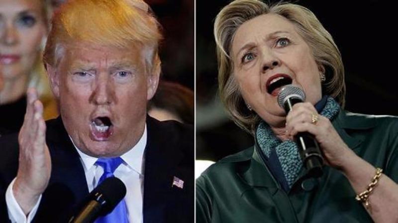 Bà Clinton (phải) quyết không để ông Trump thành tổng thống.