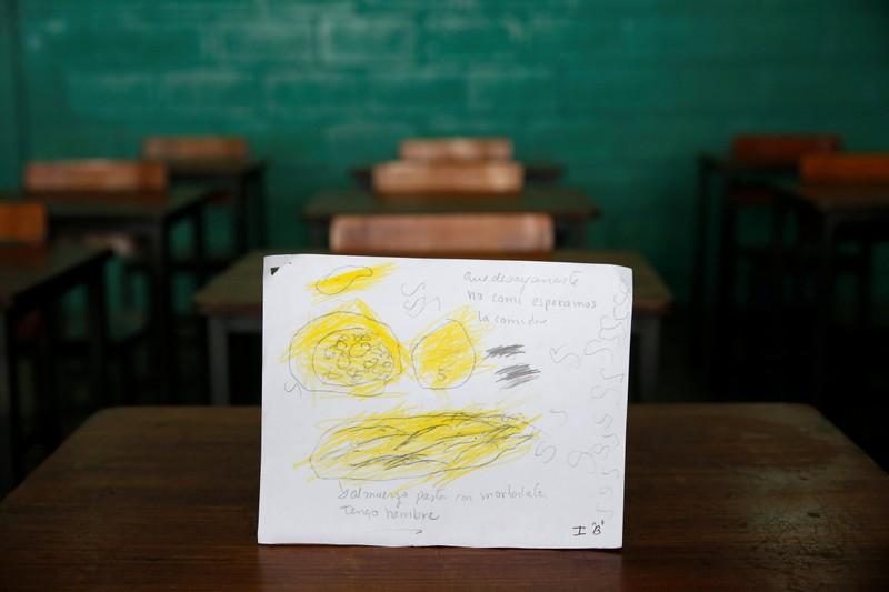 """Bức ảnh của một học sinh tiểu học mô tả sự đói của mình """"Hôm nay con không được ăn sáng, trưa con chỉ được ăn mì. Con đói.""""."""