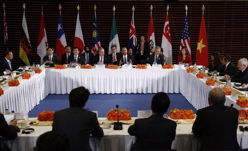 Tổng thống Obama trong cuộc họp với lãnh đạo các nước tham gia đàm phán TPP ngày 10-11-2014.
