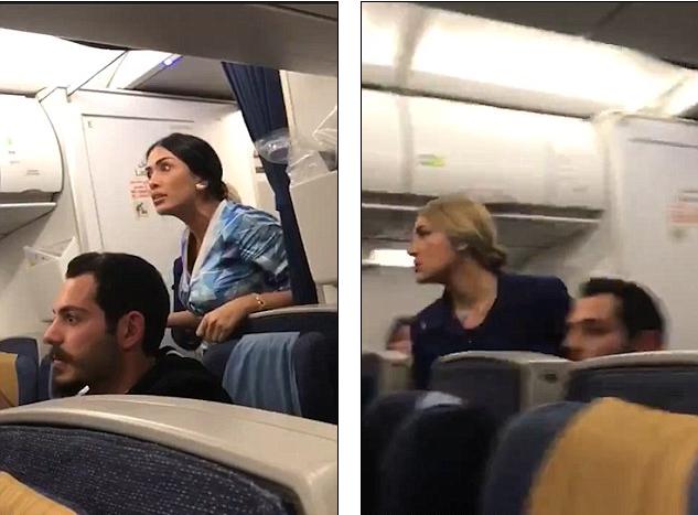 Hành khách và nhân viên trên máy bay can ngăn. Ảnh: DAILY MAIL