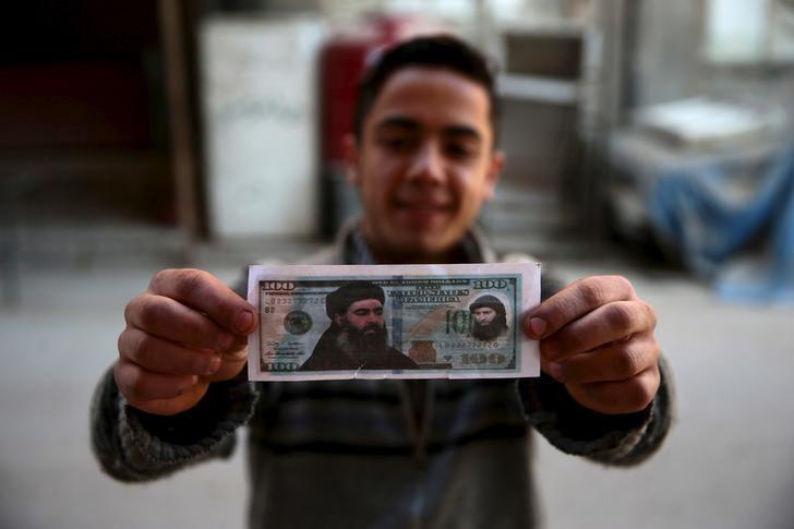 Đồng 100USD giả in hình thủ lĩnh tối cao IS Abu Bakr al-Baghdadi