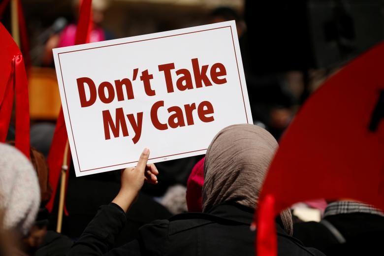 Biểu tình phản đối hủy bỏ Obamacare ở thủ đô Washington (Mỹ) ngày 23-3. Ảnh: REUTERS