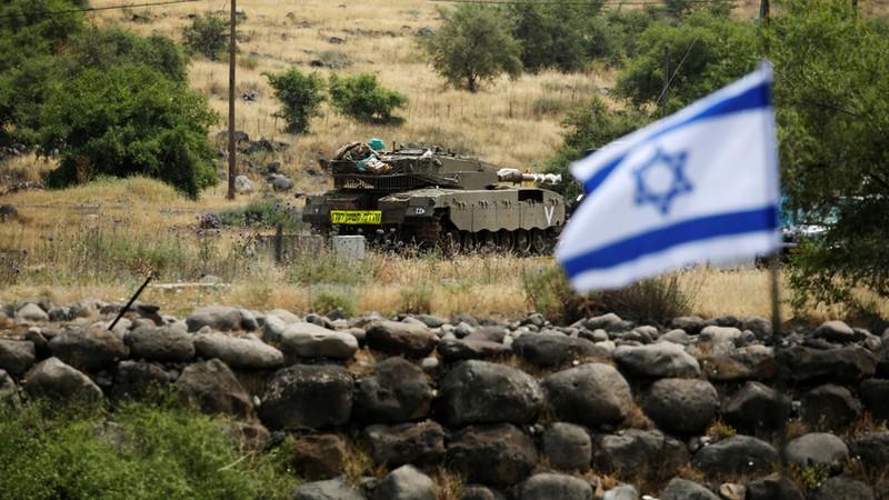 Xe tăng Israel ở Cao nguyên Golan. Ảnh: REUTERS