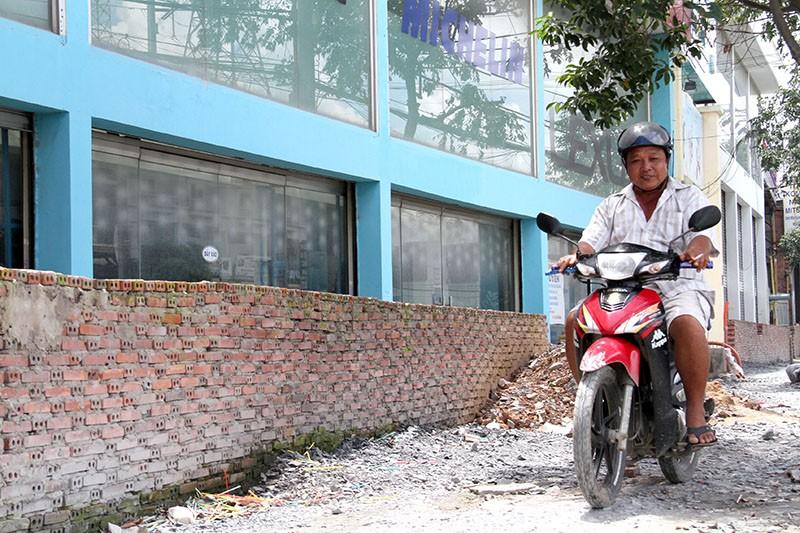 60 hộ buôn bán đóng cửa vì nâng đường Kinh Dương Vương - ảnh 1