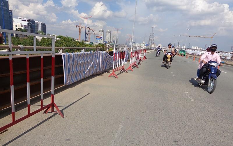 Hạn chế xe để sửa cầu vượt Nguyễn Hữu Cảnh - ảnh 5