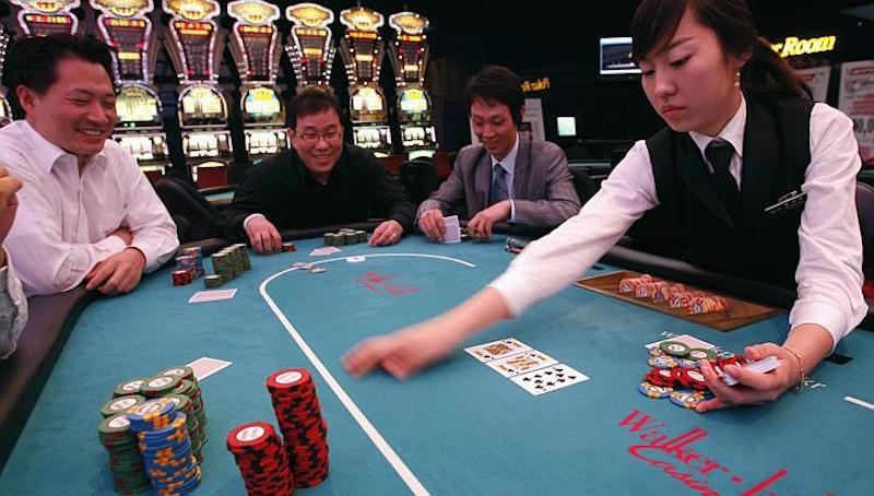 Trung Quốc phá đường dây lôi kéo đánh bạc bằng dịch vụ 'sex' - ảnh 1