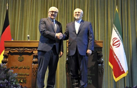 Iran bắt đầu cắt giảm hạ tầng hạt nhân - ảnh 1
