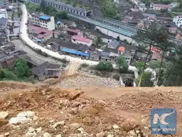 Trung Quốc: Sạt lở đất, bốn người chết, 33 người mất tích - ảnh 5