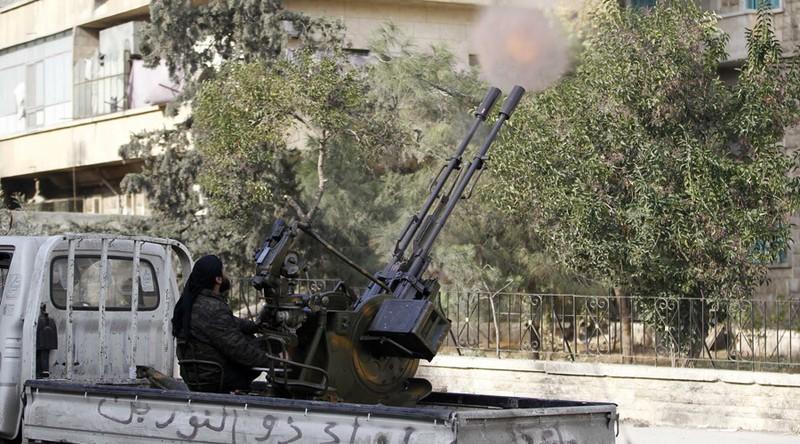 Gần 10.000 phiến quân đang bao vây Aleppo, Syria - ảnh 1