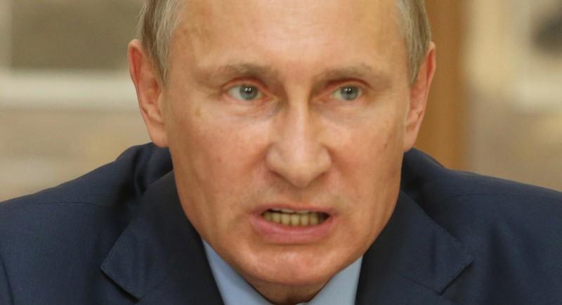 Tại sao Tổng thống Putin không cười? - ảnh 1
