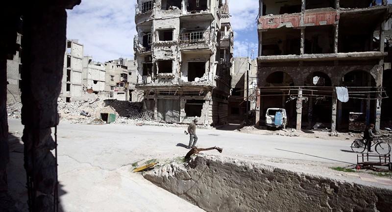 Phiến quân buông vũ khí, rời khỏi Đông Ghouta - ảnh 1