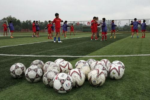 Trung Quốc hành động để trở thành cường quốc bóng đá - ảnh 1