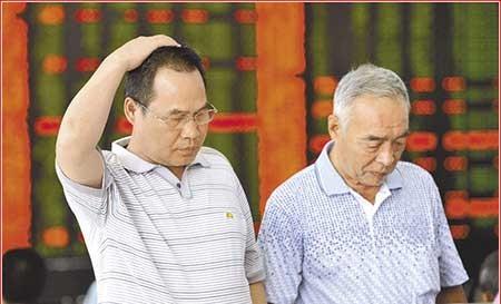 Trung Quốc điều tra gian lận chứng khoán - ảnh 1