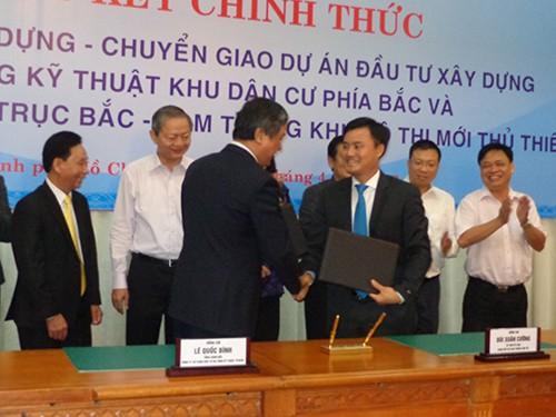 Ký kết hợp đồng xây dựng đường trục Bắc-Nam ở Thủ Thiêm - ảnh 1