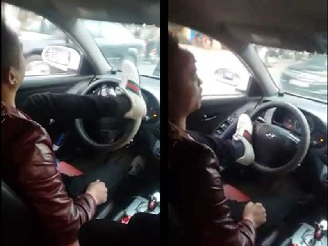 Sốc với thanh niên dùng chân lái ô tô giữ phố Hà Nội - ảnh 1