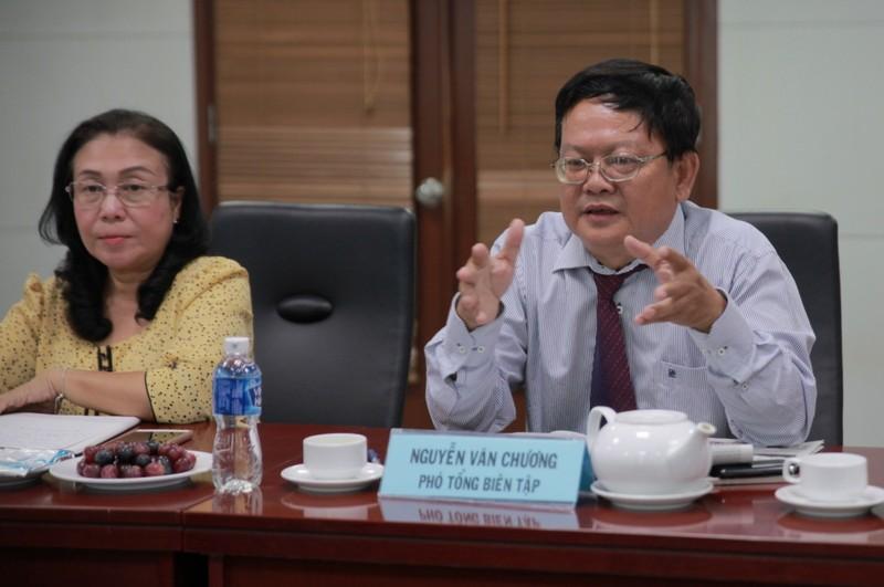 Đoàn nhà báo Lào thăm báo Pháp Luật TP.HCM - ảnh 1