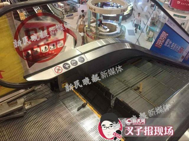 Thang cuốn Trung Quốc lại kẹt đứt chân người - ảnh 1