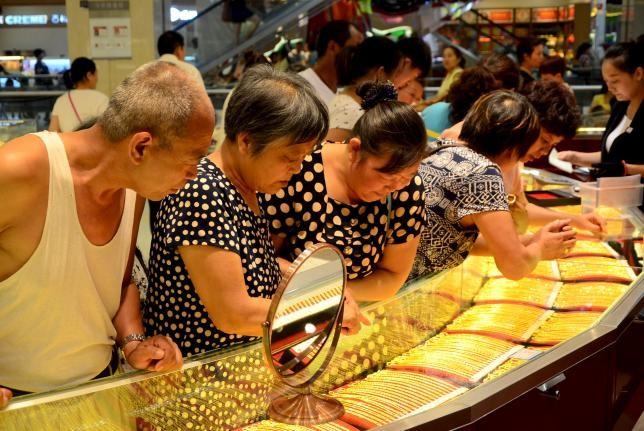 Trung Quốc: Nhân dân tệ mất giá vẫn không 'khát vàng'? - ảnh 1