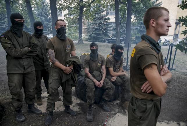 Đức lo ngại miền Đông Ukraine như 'thùng thuốc nổ' - ảnh 1