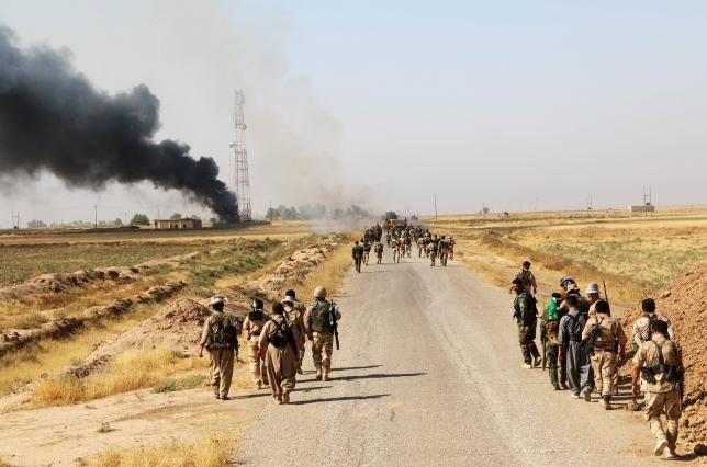 Người Kurd tiếp tục tái chiếm lãnh thổ từ tay IS - ảnh 1